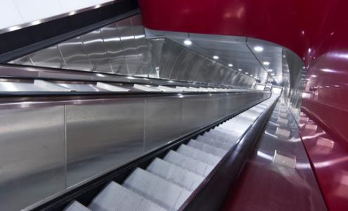 rivestimento in corian rosso scale mobili stazione Manzoni Roma