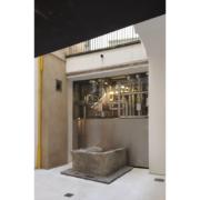Ancient fountain inside Palazzo Rhinoceros courtyard restored by Devoto Design