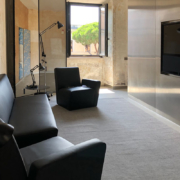Palazzo Rhinoceros apartment with bespoke stainless steel cabinets and armchairs by Jean Nouvel Design