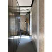 Palazzo Rhinoceros corridor with bespoke stainless steel cabinets and furniture by Jean Nouvel Design