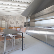 Custom-made stainless steel kitchenette and furniture designed by Jean Nouvel Design for Palazzo Rhinoceros