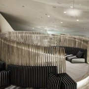 Café 875 National Museum of Qatar by Devoto Design custom-made round wooden seating