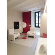 Palazzo Rhinoceros artist studio with red and white bespoke interiors