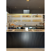 Detail of counter and interiors of Opera bakery shop, designed and delivered by Devoto Design