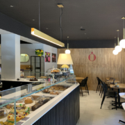 Detail of cladding and counter of Opera bakery shop, designed and delivered by Devoto Design