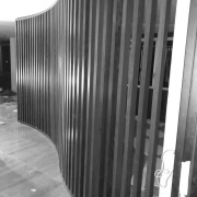 curving separation wall in wood